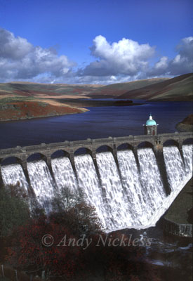 Craig Goch reservoir overflowing the magnificent dam